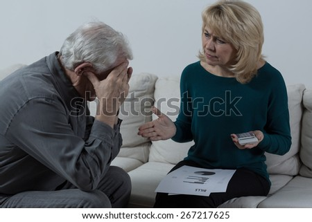 Picture of senior couple having financial troubles - stock photo
