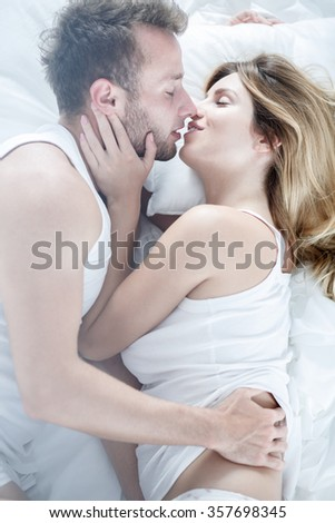 Picture of sexy boyfriend and girlfriend kissing - stock photo