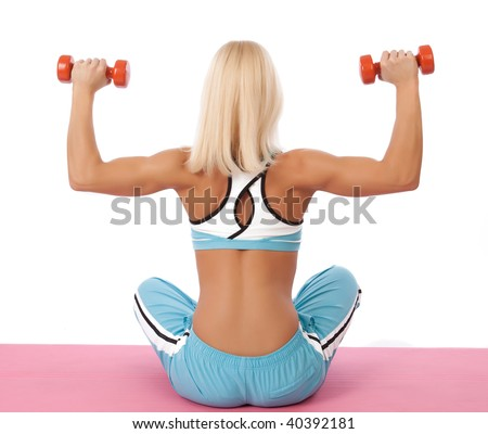 Picture of sexy sportswoman with weights sitting on mat