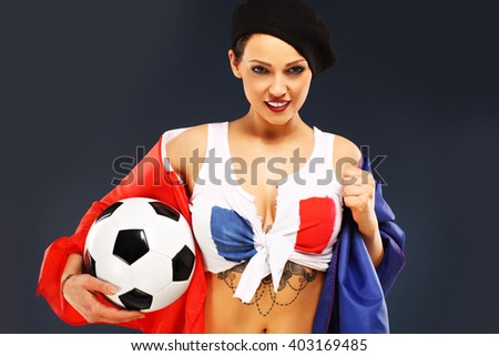 Picture of sexy woman wearing french flag and holding football - stock photo