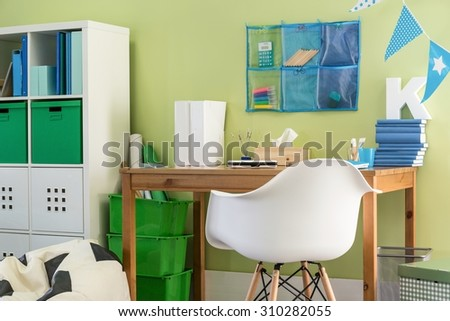 Picture of simple wooden desk and chair for schoolchild - stock photo