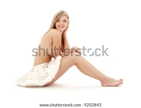 picture of sitting topless blond in furry skirt - stock photo