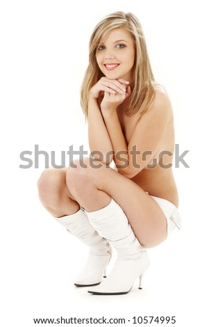 picture of sitting topless blond in white boots and panties - stock photo
