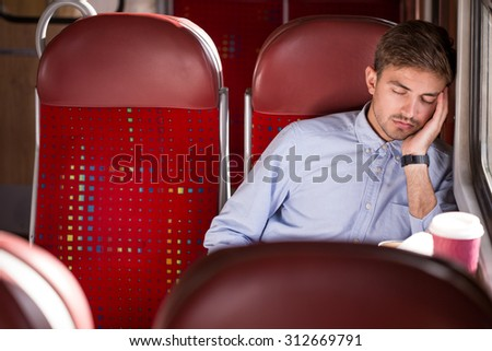 Picture of sleeping male passenger using public transport - stock photo
