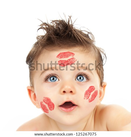 Picture of small cute Cupid, closeup portrait of pretty child with red kisses on his cheeks isolated on white background, curious little boy with beautiful blue eyes looking in camera, Valentine day - stock photo