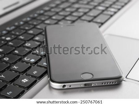 Picture of smartphone and laptop, close up photo - stock photo