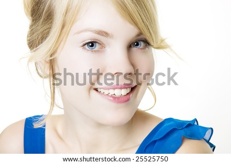 Picture of smiling blond girl in blue