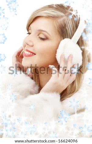 picture of smiling blond in furry headphones - stock photo