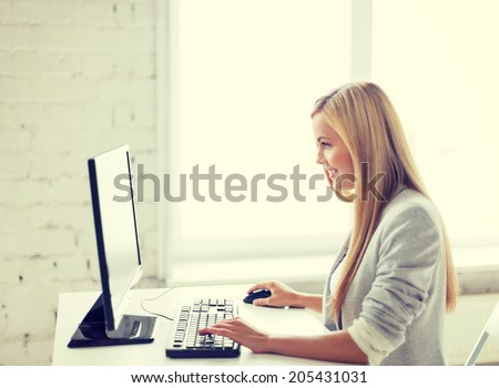 picture of smiling businesswoman with computer in office - stock photo
