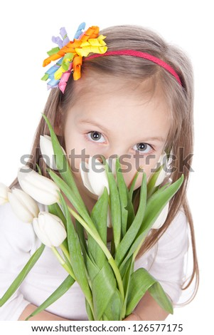 Picture of smiling little girl with white tulips in hands over white - stock photo