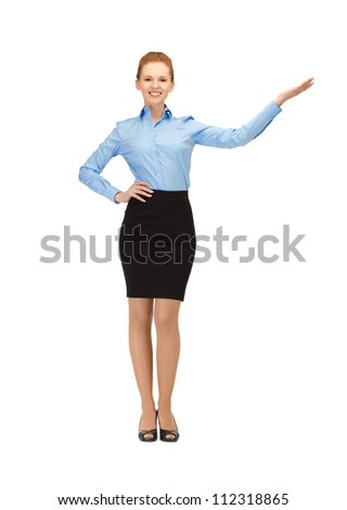picture of smiling stewardess showing direction - stock photo