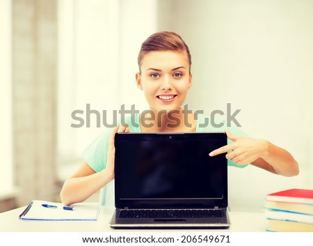 picture of smiling student girl with laptop at school - stock photo