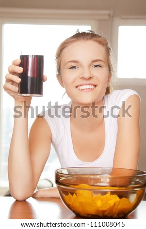 picture of smiling teenage girl with chips - stock photo