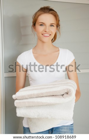 picture of smiling teenage girl with towels - stock photo
