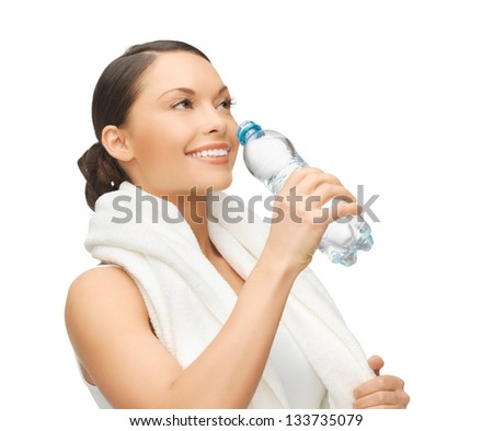 picture of sporty woman with bottle of water - stock photo