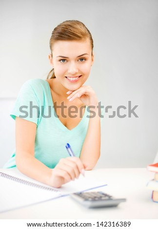 picture of student girl with notebook and calculator - stock photo