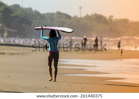 Picture of Surfer Girl in the Ocean. - stock photo