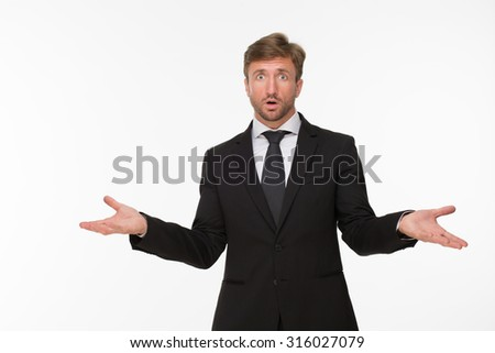 Picture of surprised businessman at a loss. Handsome man posing with amazement isolated on white background. - stock photo