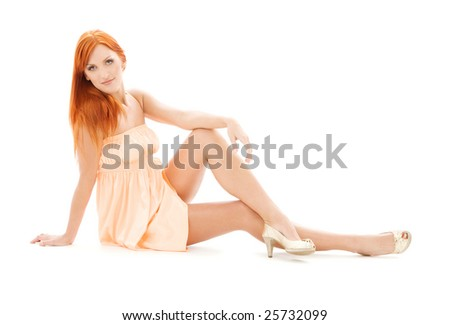 picture of tall redhead woman over white