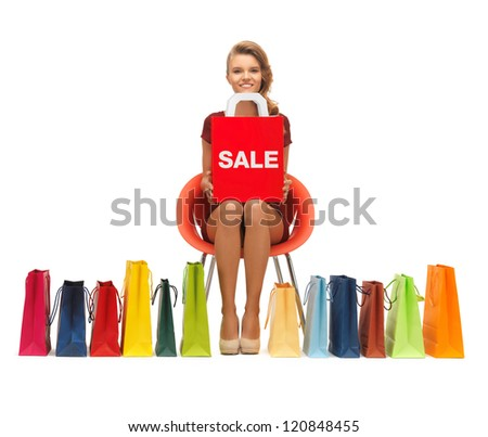 picture of teenage girl in red dress with shopping bags - stock photo