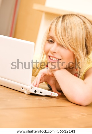 picture of teenage girl with laptop computer - stock photo