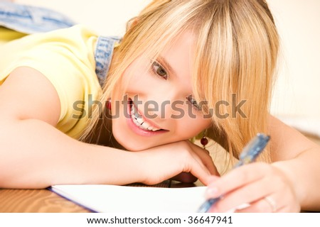 picture of teenage girl with notebook and pen