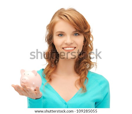 picture of teenage girl with piggy bank - stock photo