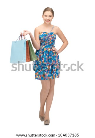 picture of teenage girl with shopping bags - stock photo