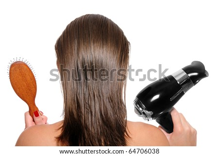 Picture of the back of a woman with long hair over white background with hair dryer and hairbrush