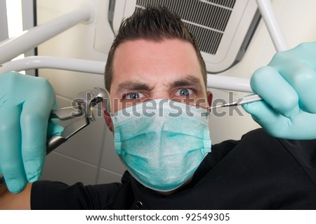 Picture of the dentist, as seen from the patient's point of view, lying in the chair