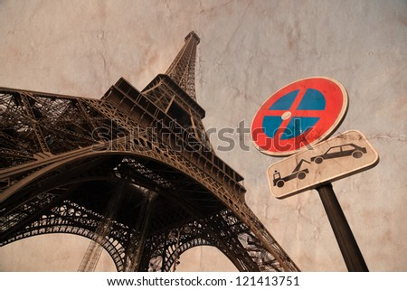picture of the Eiffel Tower with a no parking sign overlaid with a paper texture