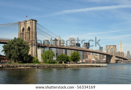 Picture of the iconic Brooklyn Bridge in New York City, taken from the Brooklyn shoreline looking across towards Manhattan - stock photo