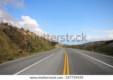 Picture of the view of empty road at New Zealand. - stock photo