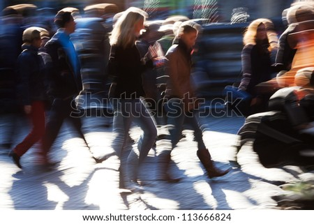 picture of the walking crowd in the city shown in motion blur