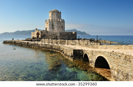 Picture of the watchthower from the medieval castle at Methoni, southern Greece, as it extends into the sea.