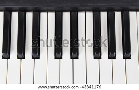 Picture of the workings keys of musical instrument on a white background