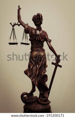 picture of Themis goddess or lady justice standing back holding sword and scale blindfold - stock photo