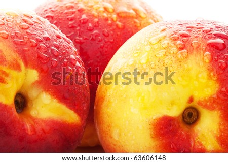 picture of three peaches with water drops on them - stock photo