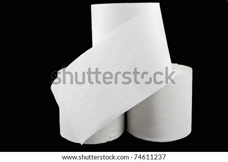 Picture of three toilet paper rolls with a protective flip - stock photo