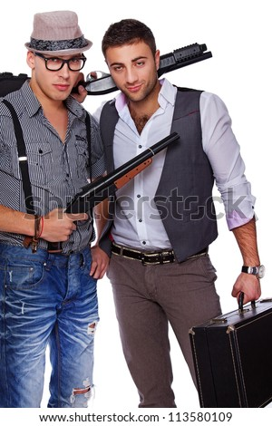 Picture of two armed men who are looking pretty dangerous