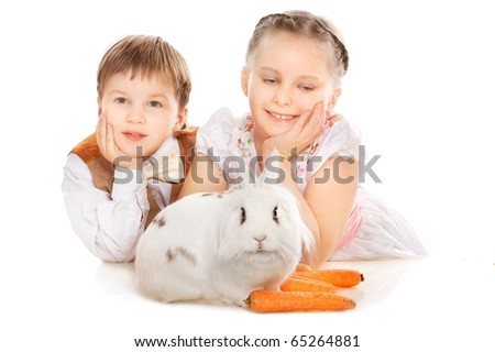 Picture of two beautiful child with small bunny