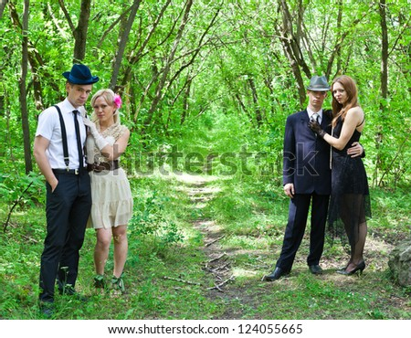 Picture of two beautiful happy couple outdoor - stock photo