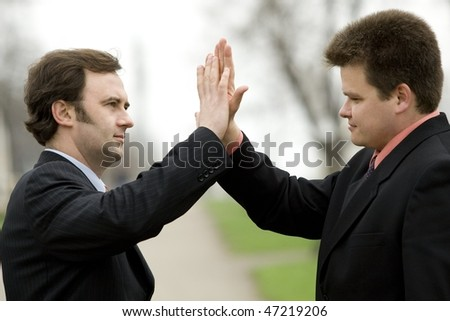 Picture of two businessmen shaking hands