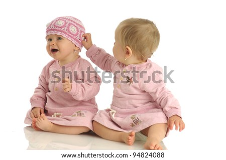 Picture of two little girls wearing same dress