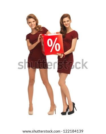 picture of two teenage girls in red dresses with percent sign - stock photo