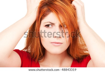 picture of unhappy redhead woman over white