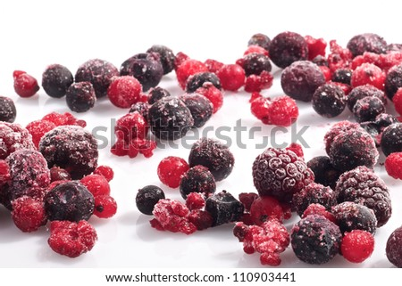 Picture of various frozen berries on a white background - stock photo