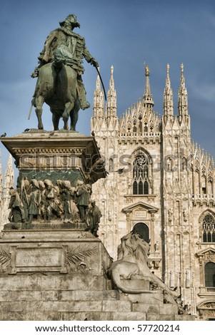 Picture of Vittorio Emanuele II Statue (Ercole Rosa, 1896) in Piazza del Duomo, Milan, Italy; Milan Cathedral Duomo di Milano on the background - stock photo