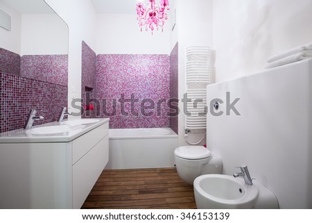 Picture of white and rose bathroom interior