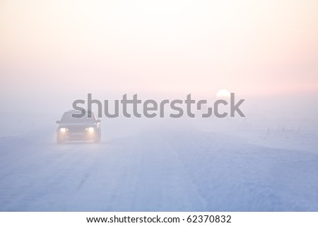 Picture of winter road and car in cold climate on sunset - stock photo